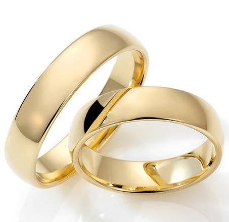 Lykkeringene glatte ringer i gult gull